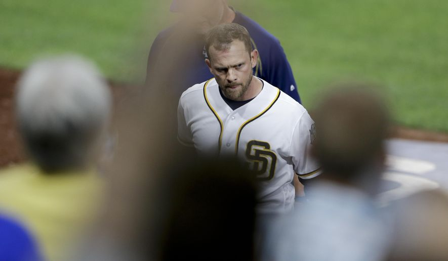San Diego Padres manager Andy Green leaves the baseball game after being ejected during the third inning against the Pittsburgh Pirates on Tuesday, April 19, 2016, in San Diego. (AP Photo/Gregory Bull)