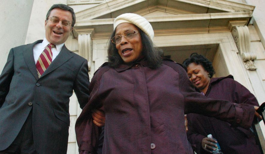 FILE - In this Dec. 6, 2005 file photo, family attorney Harold Goodman leaves the York City Hall with Hattie Dickson, center, sister of murder victim Lillie Belle Allen, and Allen's daughter, Debra Grier, after a news conference in York, Pa.  Dickson, who watched a white mob kill her sister during race riots nearly a half-century ago in Pennsylvania has died.  A funeral home says she died Monday, April 18, 2016 at York Hospital. She was 70.  (Bill Kalina/York Dispatch via AP) YORK DAILY RECORD OUT; MANDATORY CREDIT