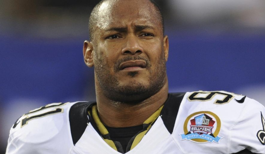 FILE - In this Dec. 9, 2012, file photo, New Orleans Saints defensive end Will Smith appears before an NFL football game against the New York Giants in East Rutherford, N.J. New Orleans police released an incident report Tuesday, April 20, 2016, saying the first officer to arrive on the scene of Smith's shooting death April 9, 2016, found a gun on the hood of a vehicle with the empty magazine removed and one round in the chamber. (AP Photo/Bill Kostroun, File)