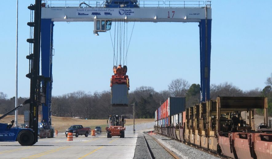 FILE - In this Jan. 24, 2014 file photo, a crane lifts a shipping container from a train and lowers it onto a truck at the South Carolina Ports Authority's inland port near Interstate 85 in Greer, S.C.  The authority announced on Wednesday, April 20, 2016, that it hopes to develop a second inland port along Interstate 95 near Dillon, S.C., in the northeastern corner of the state. (AP Photo/Bruce Smith, file)