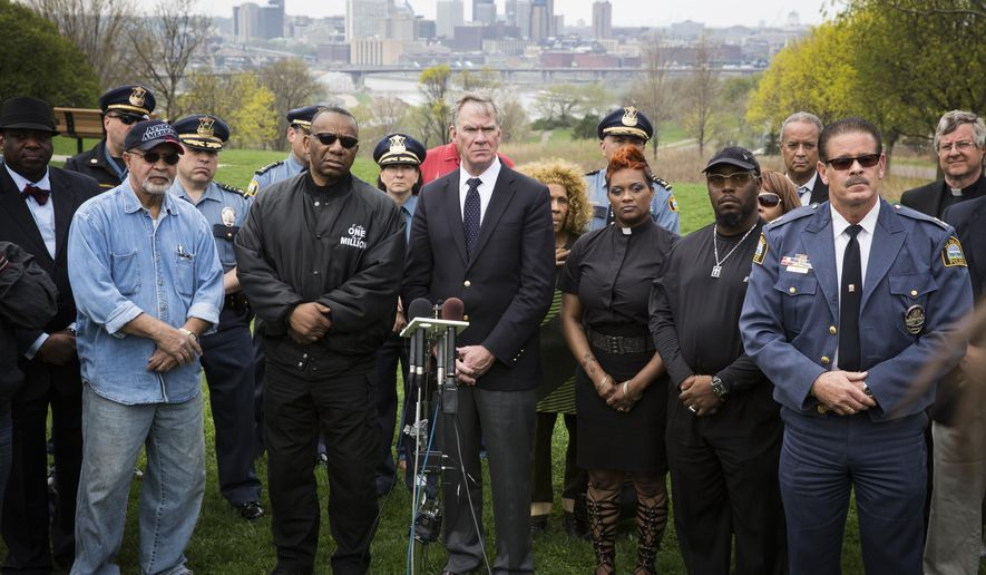 Mayor Chris Coleman, center, St Paul police Chief Thomas Smith, community and religious leaders gather for a press conference to address recent violent shootings in St. Paul, at Indian Mounds Park, Wednesday, April 20, 2016. (Leila Navidi/Star Tribune via AP)  MANDATORY CREDIT; ST. PAUL PIONEER PRESS OUT; MAGS OUT; TWIN CITIES LOCAL TELEVISION OUT