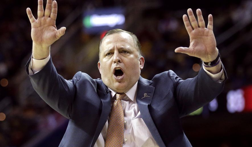FILE - In this April 5, 2015, file photo, Chicago Bulls head coach Tom Thibodeau directs his players during the fourth quarter of an NBA basketball game against the Cleveland Cavaliers in Cleveland. A person with knowledge of the situation tells The Associated Press Wednesday, April 20, 2016, that the Minnesota Timberwolves have opened negotiations with the former Bulls coach to be the team's new coach and president of basketball operations.  (AP Photo/Tony Dejak, File)