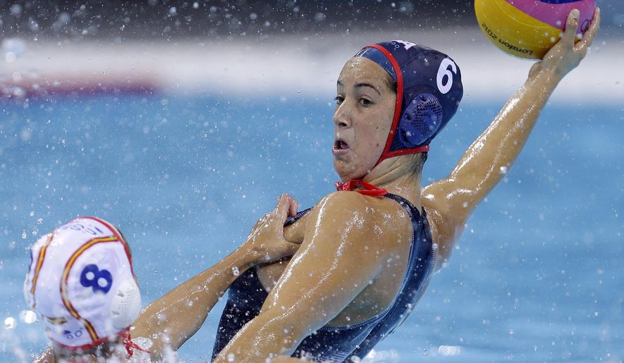 FILE - In this Wednesday, Aug. 1, 2012 file photo, United States' Maggie Steffens, right, is challenged for the ball by Pilar Pena Carrasco of Spain during their women's water polo preliminary round match at the 2012 Summer Olympics in London. Four years after she powered the United States to gold in London, the home stretch before the Rio Olympics finds Steffens in a much different spot. Once one of the youngest players on the team, now she is one of the leaders, Wednesday, April 20, 2016. (AP Photo/Alastair Grant, File)