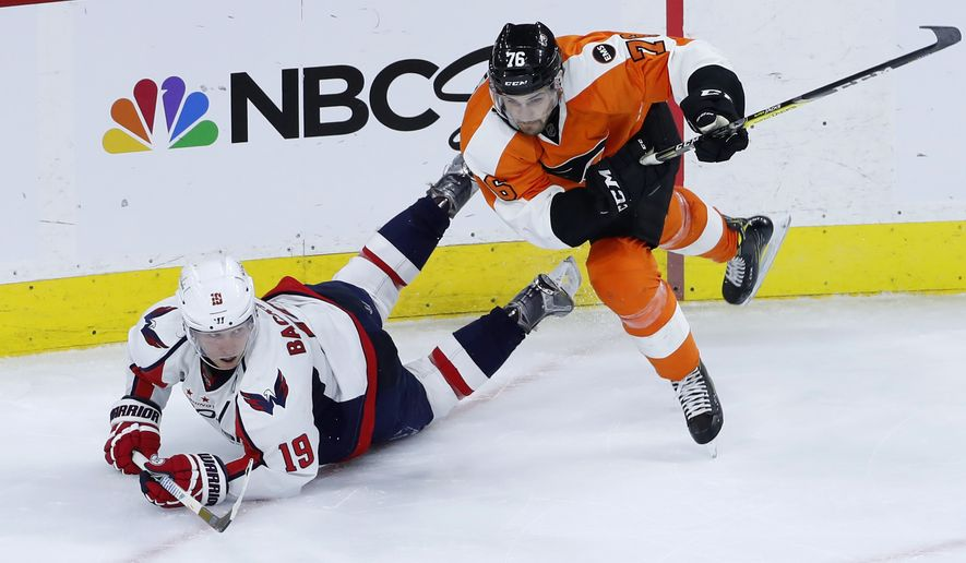 Philadelphia Flyers' Chris VandeVelde, right, checks Washington Capitals' Nicklas Backstrom during the third period of Game 4 in the first round of the NHL Stanley Cup hockey playoffs, Wednesday, April 20, 2016, in Philadelphia. Philadelphia won 2-1. (AP Photo/Matt Slocum)