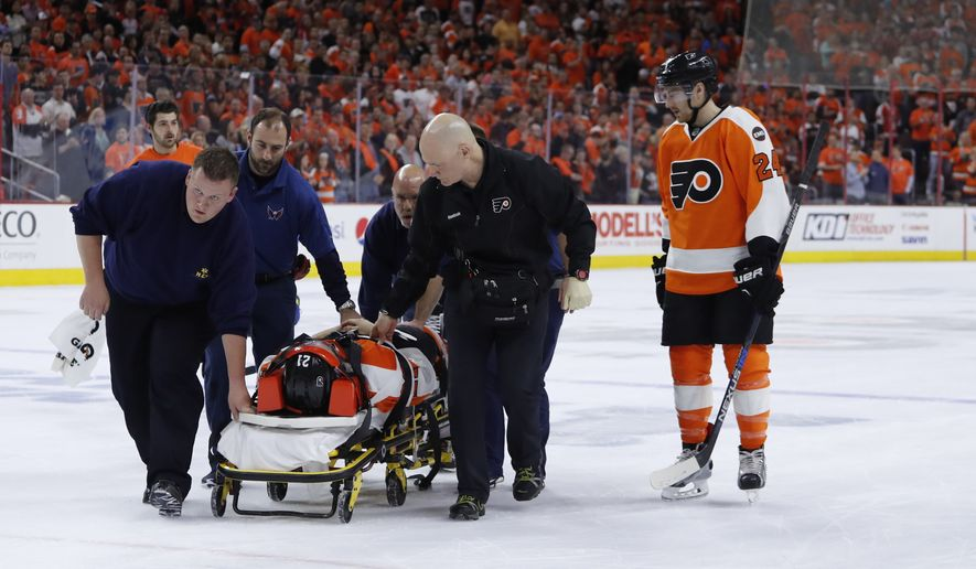 Philadelphia Flyers' Scott Laughton is taken off the ice after an injury during Game 4 in the first round of the NHL Stanley Cup hockey playoffs against the Washington Capitals, Wednesday, April 20, 2016, in Philadelphia. (AP Photo/Matt Slocum)