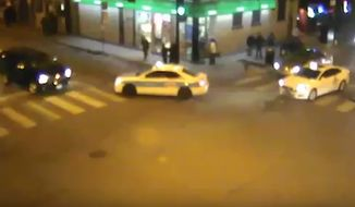 The family of a Chicago man who was knocked unconscious, robbed and then run over by a passing cab as onlookers did nothing is suing the cab driver and the 7-Eleven where the altercation began. (YouTube)