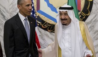 President Barack Obama and Saudi Arabia's King Salman stand together for the Leaders Photo at the Diriyah Palace during the Gulf Cooperation Council Summit in Riyadh, Saudi Arabia, Thursday, April 21, 2016. The president is on a six day trip to strategize with his counterparts in Saudi Arabia, Britain and Germany on a broad range of issues with efforts to rein in the Islamic State group being the common denominator in all three stops. (AP Photo/Carolyn Kaster)