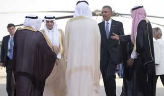 President Barack Obama, third from right, and Saudi Foreign Minister Adel al-Jubeir, third from left, are greeted at King Khalid International Airport in Riyadh, Saudi Arabia, Thursday, April 21, 2016, before the president boards Air Force One en route to London after participating in the Gulf Cooperation Council Summit. The president is on a six day trip to strategize with his counterparts in Saudi Arabia, England and Germany on a broad range of issues with efforts to rein in the Islamic State group being the common denominator in all three stops. (AP Photo/Carolyn Kaster)