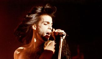 """In this May 2, 1990 photo Prince performs a benefit concert for the family of Charles (Big Chick) Huntsberry in Minneapolis. Prince, widely acclaimed as one of the most inventive and influential musicians of his era with hits including """"Little Red Corvette,"""" ''Let's Go Crazy"""" and """"When Doves Cry,"""" was found dead at his home on Thursday, April 21, 2016 in suburban Minneapolis, according to his publicist. He was 57. (David Brewster/Star Tribune via AP)  MANDATORY CREDIT; ST. PAUL PIONEER PRESS OUT; MAGS OUT; TWIN CITIES LOCAL TELEVISION OUT"""