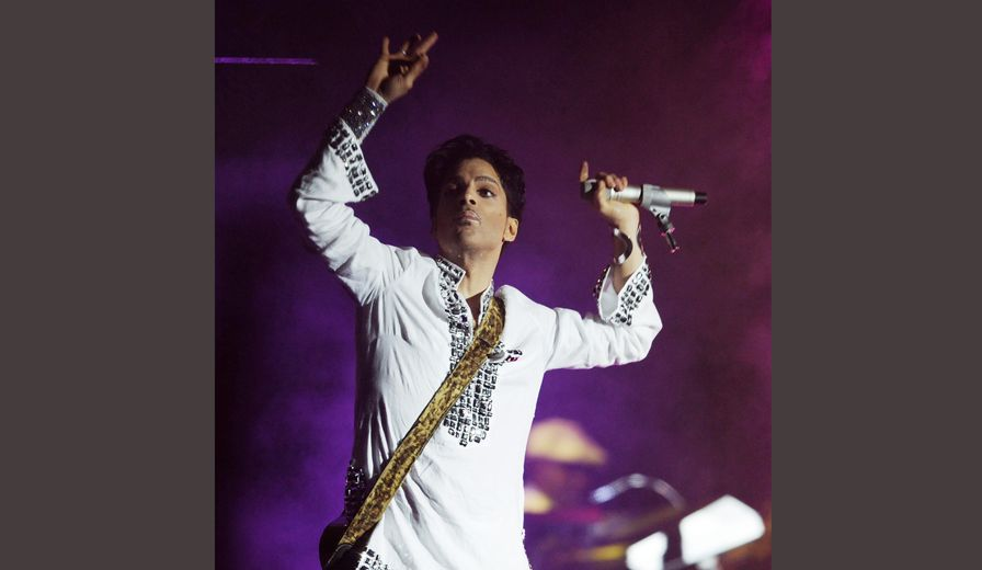 FILE - In this April 26, 2008  file photo, Prince performs during the second day of the Coachella Valley Music and Arts Festival in Indio, Calif. Prince's publicist has confirmed that Prince died at his his home in Minnesota, Thursday, April 21, 2016. He was 57. (AP Photo/Chris Pizzello, File)