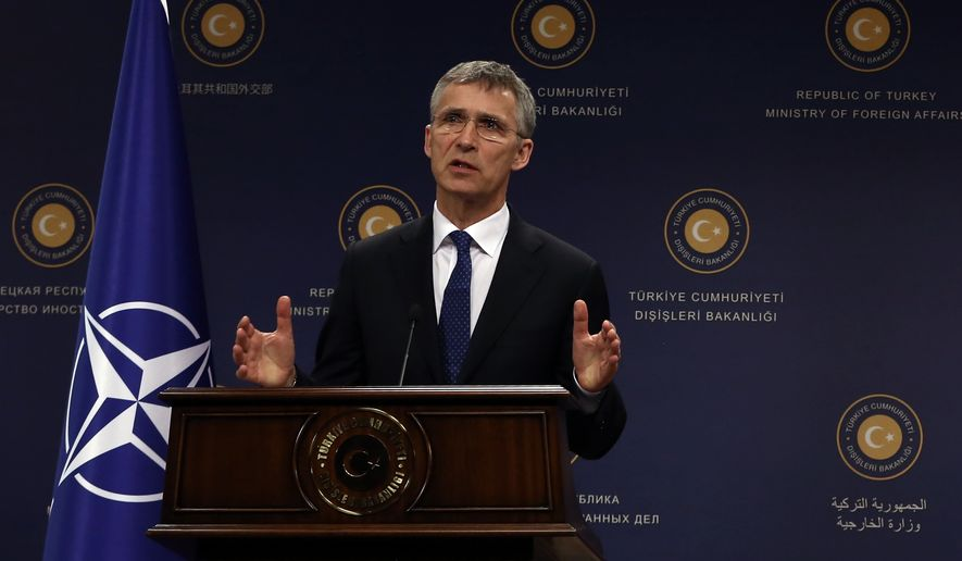 NATO Secretary General Jens Stoltenberg speaks to the media during a joint news conference with Turkish Foreign Minister Mevlut Cavusoglu in Ankara, Turkey, Thursday, April 21, 2016.  Stoltenberg says efforts to stem the tide of migrants seeking the shores of Europe are working.(AP Photo/Burhan Ozbilici)