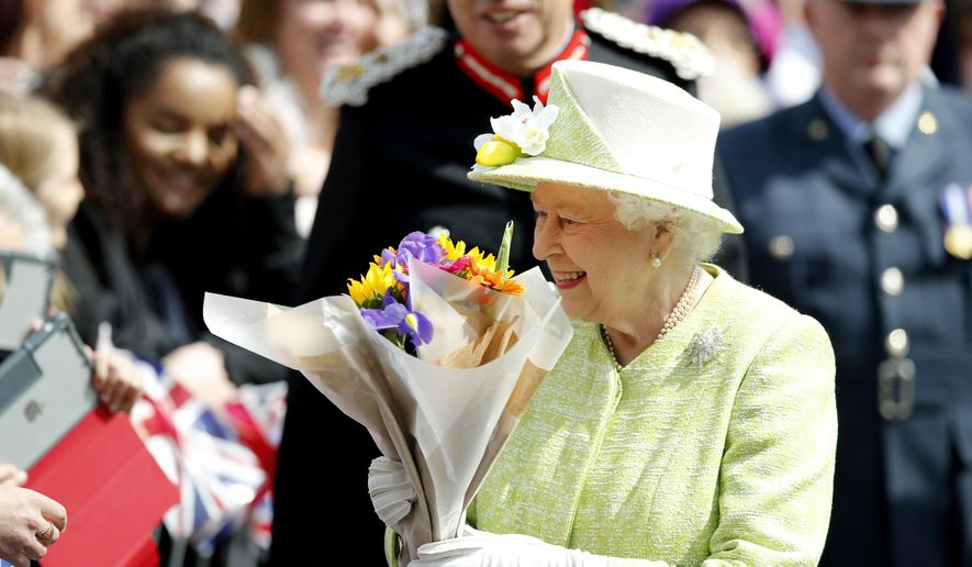 Britain's Queen Elizabeth II meets well wishers during a walkabout to celebrate her 90th birthday in Windsor, England, Thursday April 21, 2016. The queen was born Princess Elizabeth on April 21, 1926, and became queen at 25 upon the death of her father, King George VI, in 1952. A majority of Britons have lived under no other monarch. (AP Photo/Alastair Grant)