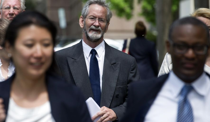 Douglas Hughes arrives at the Federal Courthouse in Washington, Thursday, April 21, 2016. Hughes, from Ruskin, Fla., flew a gyrocopter into restricted airspace over Washington, D.C., and is scheduled to be sentenced today.(AP Photo/Cliff Owen)