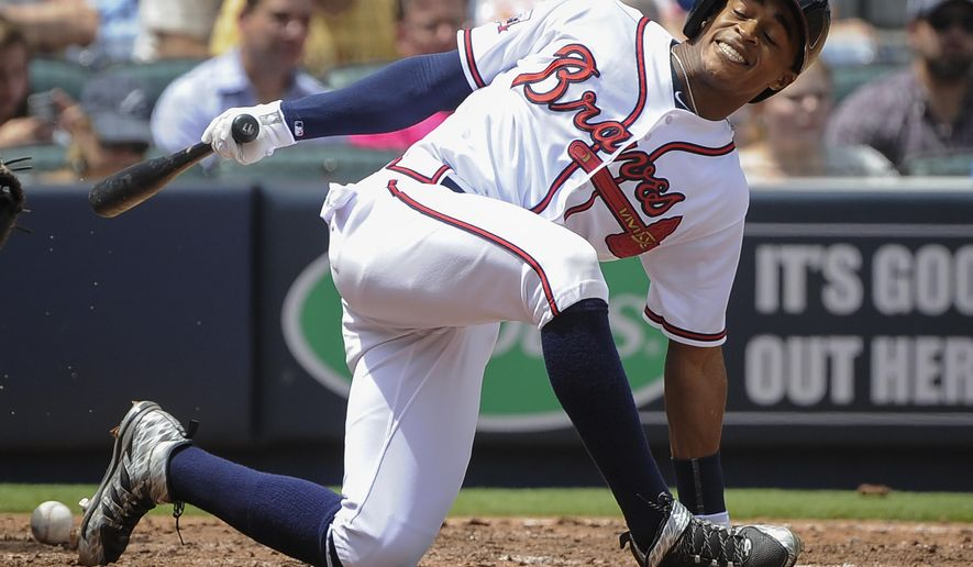 Atlanta Braves' Mallex Smith loses his balance as he strikes out swinging at a pitch by Los Angeles Dodgers pitcher Clayton Kershaw during the fourth inning of a baseball game, Thursday, April 21, 2016, in Atlanta. (AP Photo/John Amis)