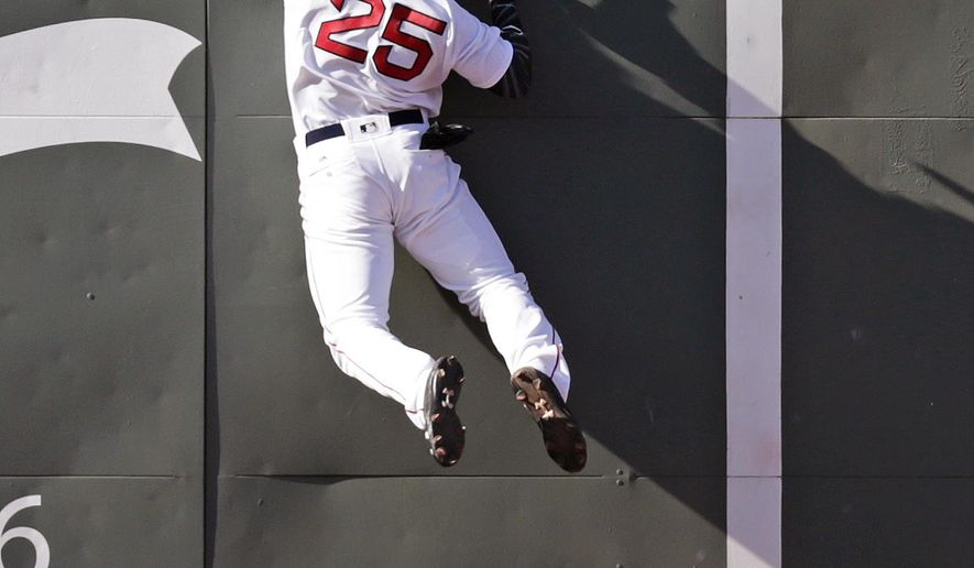 Boston Red Sox center fielder Jackie Bradley Jr. collides with the wall as he stretches but fails to make the catch on an RBI double by Tampa Bay Rays' Steven Souza Jr. during the eighth inning of an MLB baseball game in Boston, Thursday, April 21, 2016. (AP Photo/Charles Krupa)