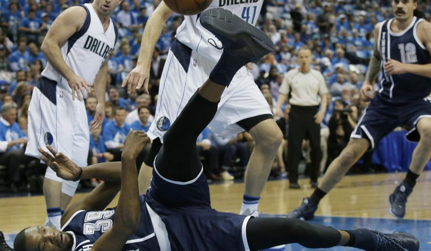 Oklahoma City Thunder forward Kevin Durant (35) falls down in front of Dallas Mavericks forward Dirk Nowitzki (41) and guard J.J. Barea (5) during the first half in Game 3 of a first-round NBA basketball playoff series Thursday, April 21, 2016, in Dallas. (AP Photo/LM Otero)