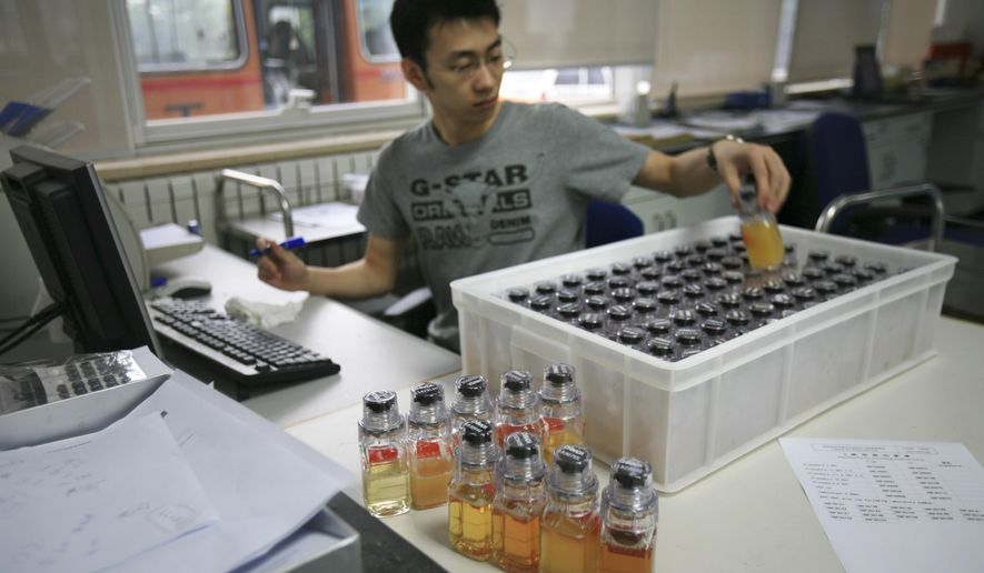 """FILE - In this Monday, June 30, 2008 file photo, urine samples from Chinese athletes are recorded upon arriving at China Anti-Doping Agency in Beijing. The World Anti-Doping Agency has suspended China's National Anti-Doping Laboratory, Thursday, April 21, 2016, for a maximum period of four months for """"non-conformities"""" with standards. (AP Photo/Robert F. Bukaty, File)"""