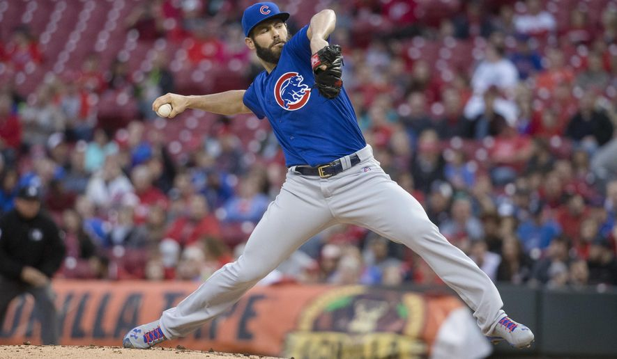 Chicago Cubs starting pitcher Jake Arrieta throws in the first inning of a baseball game against the Cincinnati Reds, Thursday, April 21, 2016, in Cincinnati. (AP Photo/John Minchillo)