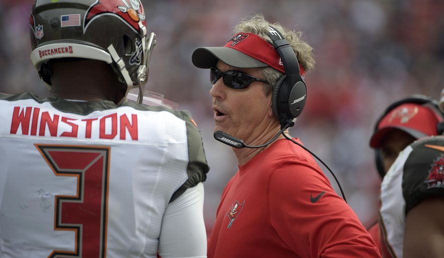 FILE - In this Nov. 15, 2015, file photo, Tampa Bay Buccaneers offensive coordinator Dirk Koetter talks to quarterback Jameis Winston (3) during an NFL football game against the Dallas Cowboys, in Tampa, Fla. The Buccaneers  have the 9th pick in the first round in next week's NFL draft in Chicago. (AP Photo/Phelan M. Ebenhack, File)
