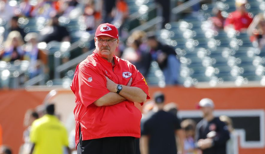 FILE - In this Oct. 4, 2015, file photo, Kansas City Chiefs coach Andy Reid stands on the field as players warm up for an NFL football game against the Cincinnati Bengals in Cincinnati. The Chiefs  have the 28th pick in the first round in next week's NFL draft in Chicago. (AP Photo/Paul Sancya. File)
