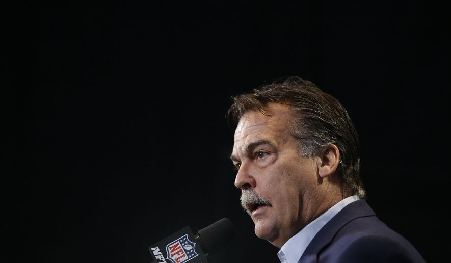 FILE - In this Feb. 24, 2016, file photo, Los Angeles Rams head coach Jeff Fisher responds to a question during a news conference at the NFL football scouting combine in Indianapolis. The Rams have the No. 1 pick in the first round in next week's NFL draft in Chicago.  (AP Photo/Darron Cummings, File)