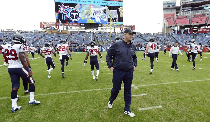 FILE - In this Dec. 27, 2015, file photo, Houston Texans coach Bill O'Brien watches players warm up for an NFL football game against the Tennessee Titans in Nashville, Tenn. The Titans  have the 15th pick in the first round in next week's NFL draft in Chicago. (AP Photo/Mark Zaleski, File)