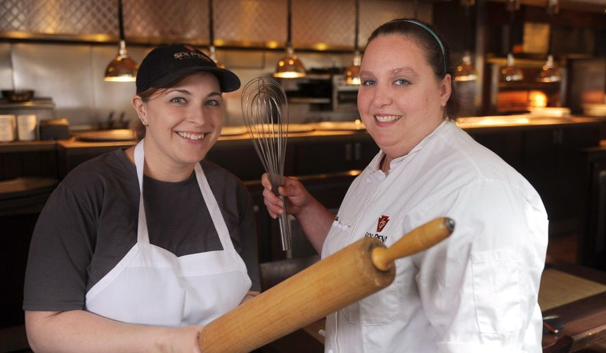 In this April 11, 2016 photo, from left,  pastry chef's Lisa O'Connor and Amanda Williams pose for a photograph at Six Penn Kitchen, in Pittsburgh. The pastry chefs have been at Six Penn Kitchen  from when it first opened almost 11 years ago. While O'Connor focuses on baking breads and desserts for lunch, Williams comes in at 5 p.m. and works until 1 a.m., spearheading the dinner scene. (Nate Guidry/Pittsburgh Post-Gazette via AP) MAGS OUT; MONESSEN OUT; KITTANNING OUT; CONNELLSVILLE OUT; GREENSBURG OUT; TARENTUM OUT; NORTH HILLS NEWS RECORD OUT; BUTLER OUT; MANDATORY CREDIT