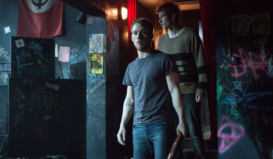 """This image released by A24 Films shows Joe Cole, left, and Callum Turner in a scene from, """"Green Room."""" (Scott Green/A24 via AP)"""