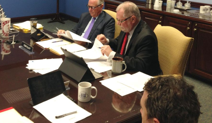 "Thomas K. Elliott, left, presides at a Kentucky Retirement Systems board of trustees meeting on Thursday, April 21, 2016, in Frankfort, Ky. Elliott took his seat at the head of the board table in defiance of Gov. Matt Bevin's order removing him from the board. Republican Gov. Matt Bevin removed the chairman of the Kentucky Retirement Systems board of trustees Wednesday, saying one of the country's worst-funded public pension systems needs a ""fresh start."" Kentucky Retirement Systems Executive Director William Thielen is on the right. (AP Photo/Bruce Schreiner)"