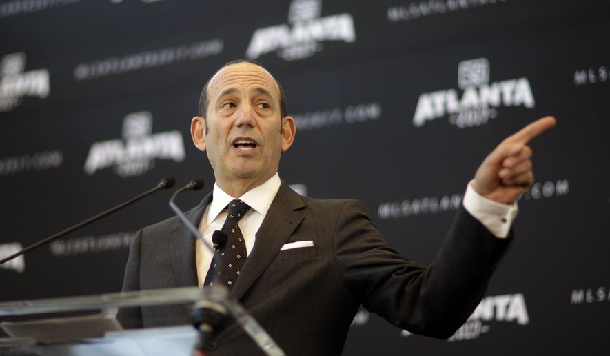 FILE - In this April 16, 2014, file photo, Major League Soccer Commissioner Don Garber speaks during a news conference in Atlanta, announcing the city will be getting an MLS expansion team.  Garber, speaking with the Associated Press Sports Editors on Thursday, April 21, 2016, says St. Louis and Sacramento, California, are the leading candidates for the next round of expansion.(AP Photo/David Goldman, File)