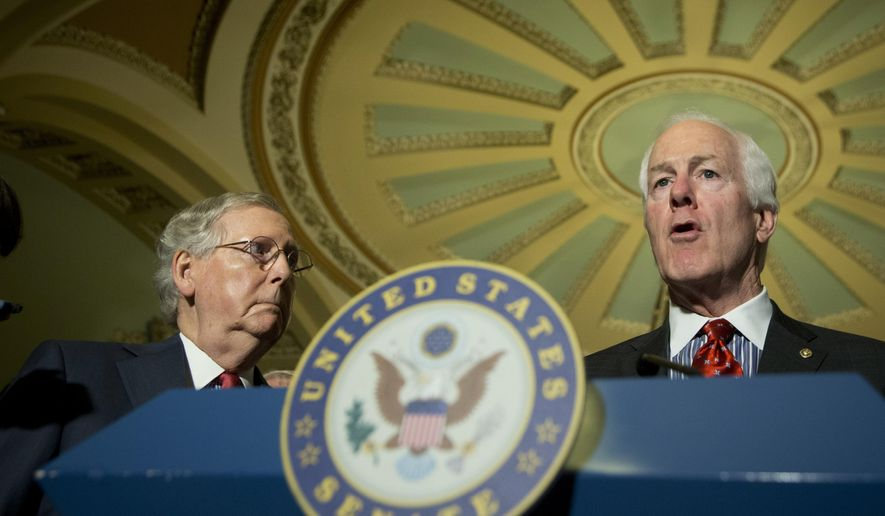 Senate Majority Leader Mitch McConnell of Ky. listens at left as Senate Majority Whip John Cornyn of Texas speaks to reporters on Capitol Hill in Washington, Tuesday, April 19, 2016. (AP Photo/Manuel Balce Ceneta)