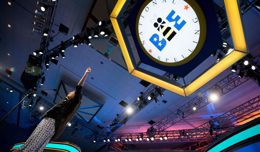 "FILE - In this May 28, 2015 file photo, Ankita Vadiala, 13, of Manassas, Va. reacts as she correctly spells ""improvisatrice"" during the semifinals of the 2015 Scripps National Spelling Bee in Oxon Hill, Md. After two straight years of ties, the Scripps National Spelling Bee is adding more sting: The championship rounds will last longer, and the words will be harder. (AP Photo/Andrew Harnik, File)"