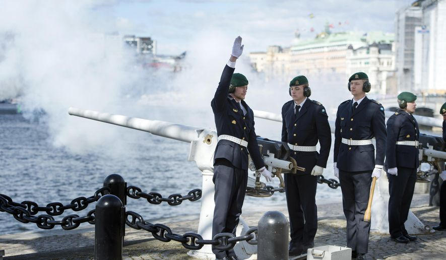 A unit from the Royal Swedish Navy fire a 21-gun salute to celebrate the newborn Prince, from the Skeppsholmen Island in front of the Royal Palace in Stockholm, Wednesday, April 20, 2016. Sweden's Princess Sofia has given birth to a baby boy. He is the first child of Prince Carl Philip and Sofia, who got married last year. (Jessica Gow/TT News Agency via AP)      SWEDEN OUT