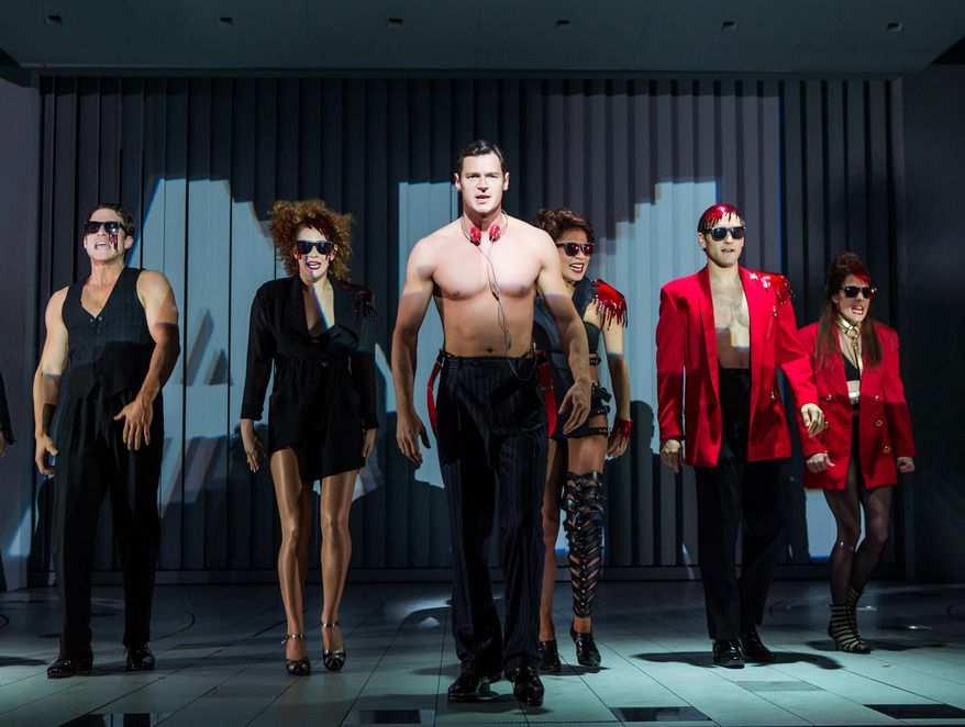 """This image released by Jeffrey Richards Associates shows Benjamin Walker, center, and the cast during a performance of """"American Psycho,"""" opening at the Gerald Schoenfeld Theatre in New York. (Jeremy Daniel/Jeffrey Richards Associates via AP)"""