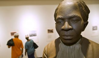 A statue of Harriett Tubman is the centerpiece of the History Gallery at the Tubman Museum, Wednesday, April 20, 2016, in Macon, Ga. (Woody Marshall/The Telegraph via AP) ** FILE **