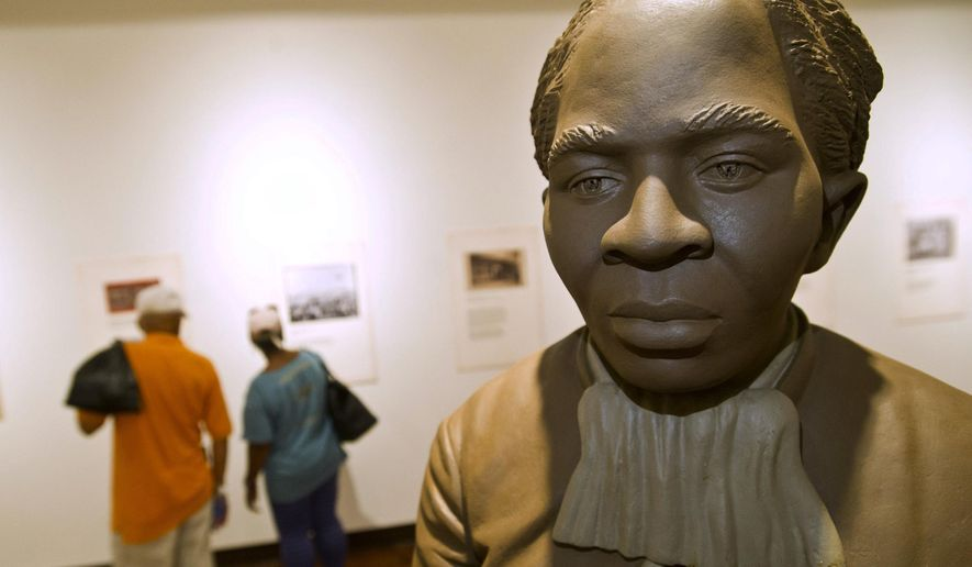 A statue of Harriett Tubman is the centerpiece of the History Gallery at the Tubman Museum, Wednesday, April 20, 2016, in Macon, Ga. Tubman, a prominent anti-slavery activist, will be the first African-American to appear on an American banknote and the first woman to appear on one in a century. Her portrait will replace former President Andrew Jackson, who will be moved to the back of the redesigned $20 bill. Ezzell and Beverly Hart Pittman from Columbia, SC, visit the museum Wednesday afternoon. (Woody Marshall/The Telegraph via AP) **FILE**