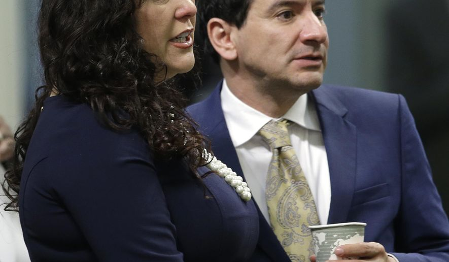 Assemblywoman Lorena Gonzalez, D-San Diego, talks with Assembly Speaker Anthony Rendon, D-Paramount, during the Assembly session, Thursday, April 21, 2016, in Sacramento, Calif. Gonzalez announced Thursday, that she has withdrawn her bill, AB 1727, that would allow independent contractors to unionize. (AP Photo/Rich Pedroncelli)