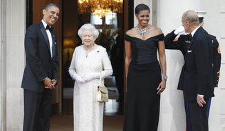In this May 25, 2011, file photo, President Barack Obama and first lady Michelle Obama welcome Britain's Queen Elizabeth II and Prince Philip for a reciprocal dinner at Winfield House in London. (AP Photo/Charles Dharapak, File) ** FILE **