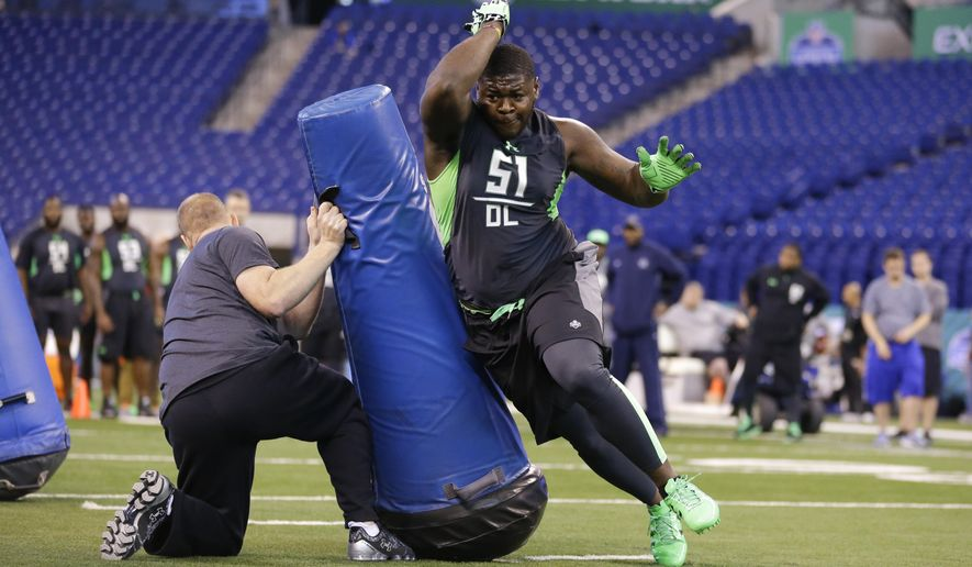FILE - In this Feb. 28, 2016, file photo, Alabama defensive lineman Jarran Reed runs a drill at the NFL football scouting combine in Indianapolis. Two people familiar with the plans have told The Associated Press that Buffalo Bills officials are visiting Alabama on Friday, April 26, 2016, to meet with Crimson Tide defensive tackle Jarran Reed, a projected first-round draft pick. The people spoke on the condition of anonymity because the meeting, which will include dinner, has not been publicized.  (AP Photo/Michael Conroy, File)