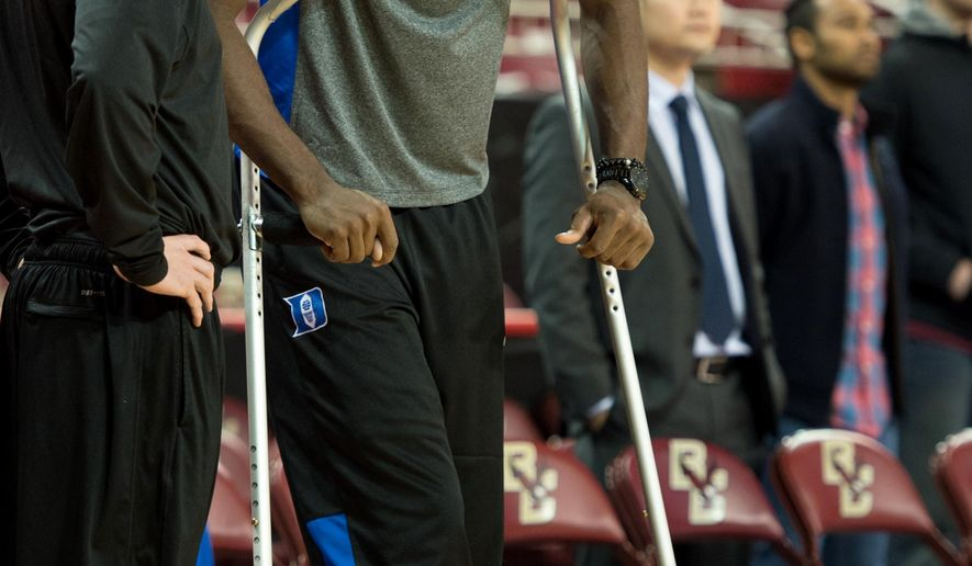 FILE - In this Jan. 2, 2016, file photo, Duke forward Amile Jefferson watches his team warm up before an NCAA college basketball game against Boston College in Boston.Jefferson will be able to play for the Blue Devils next season. The school said Friday, April 22, 2015, that the Atlantic Coast Conference approved his medical hardship waiver, which makes him eligible to play this coming season.  Jefferson played only nine games last season before breaking his right foot in December, (AP Photo/Gretchen Ertl, File)