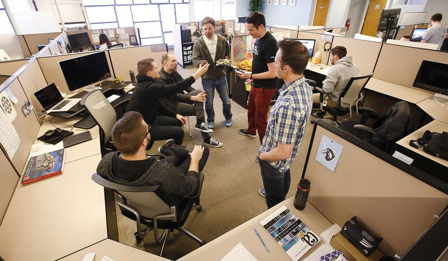 ADVANCE FOR THE WEEKEND OF APRIL 23-24 AND THEREAFTER - In a March 30, 2016 photo, Domo Technologies employees hold a standing meeting in American Fork, Utah. In the world of business, a unicorn is a company, usually a startup that may not have an established performance record, with a stock market value or estimated valuation of more than $1 billion. Utah is home to at least six unicorns including Domo Technologies. (Jeffrey D. Allred/The Deseret News via AP)  SALT LAKE TRIBUNE OUT; MAGS OUT; MANDATORY CREDIT; TV OUT