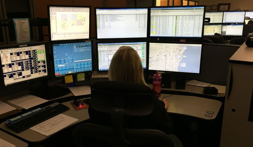 ADVANCE FOR SATURDAY, APRIL 23, 2016 - One of 14 dispatcher at the Racine County Communications Center monitors several screens at once while answering emergency calls, Friday, April 22, 2016, in Racine, Wis. The center handled 367,000 calls in 2015, more than 1,000 calls every day.  (Mark Feldmann/The Journal Times via AP) MANDATORY CREDIT
