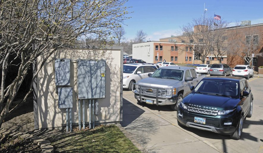ADVANCE FOR USE SUNDAY, APRIL 24 AND THEREAFTER - In this April 5, 2016 photo, a small structure on the corner of Second Avenue and First Street in northwest Mandan, N.D., and across from the Morton County Courthouse serves as a manifold for the diesel fuel remediation and is an integral part of the 285 well system throughout the city's central downtown area. The state Department of Health and the Mandan Remediation Trust recently approved closing 70 wells and eight remote manifolds, part of a system used to collect more than 1 million gallons of fuel contamination since 2007. (Tom Stromme/The Bismarck Tribune via AP)  MANDATORY CREDIT