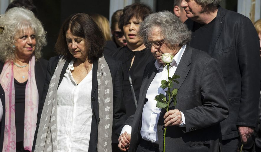 Hungarian writer Gyoergy Konrad, right, attends the funeral ceremony of Nobel Prize winner Hungarian writer Imre Kertesz in the Fiume Street National Graveyard in Budapest, Hungary, Friday, April 22, 2016. Kertesz died at his Budapest home on March 31 at age 86. (Zsolt Szigetvary/MTI via AP)