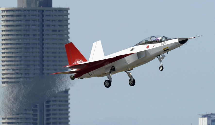 The prototype of Japan's first stealth aircraft type X-2  takes off an airport in Toyoyama, Aichi prefecture, central Japan Friday, April 22, 2016.  Japan's first domestically-manufactured stealth plane successfully made its first flight on Friday, putting the nation at the forefront of only a handful of nations with stealth capabilities.  (Kyodo News via AP) JAPAN OUT, MANDATORY