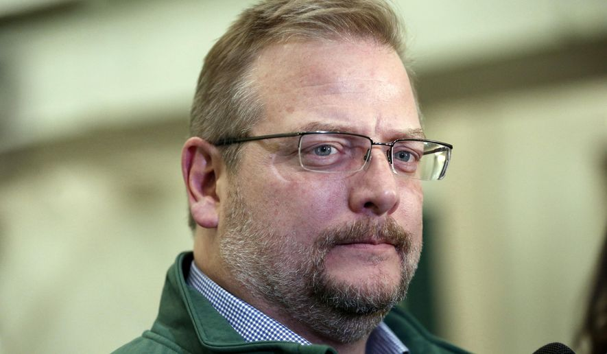 """FILE - In this Jan. 14, 2016, file photo, New York Jets Mike Maccagnan speaks to reporters at the team's NFL football training center in Florham Park, N.J. Re-signing Ryan Fitzpatrick remains a """"priority"""" for the Jets, although Maccagnan says there's not necessarily a deadline to have the quarterback back on the roster. (AP Photo/Julio Cortez, File)"""