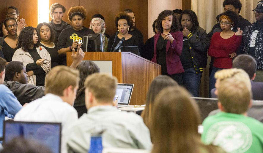 In this March 9, 2016 photo, Kansas University student Katherine Rainey, center right, speaks to the Kansas University Student Senate about a proposed Multicultural Student Government fee during the Student Senate meeting on the university campus in Lawrence, Kan. (John Young/The Lawrence Journal-World via AP) MANDATORY CREDIT