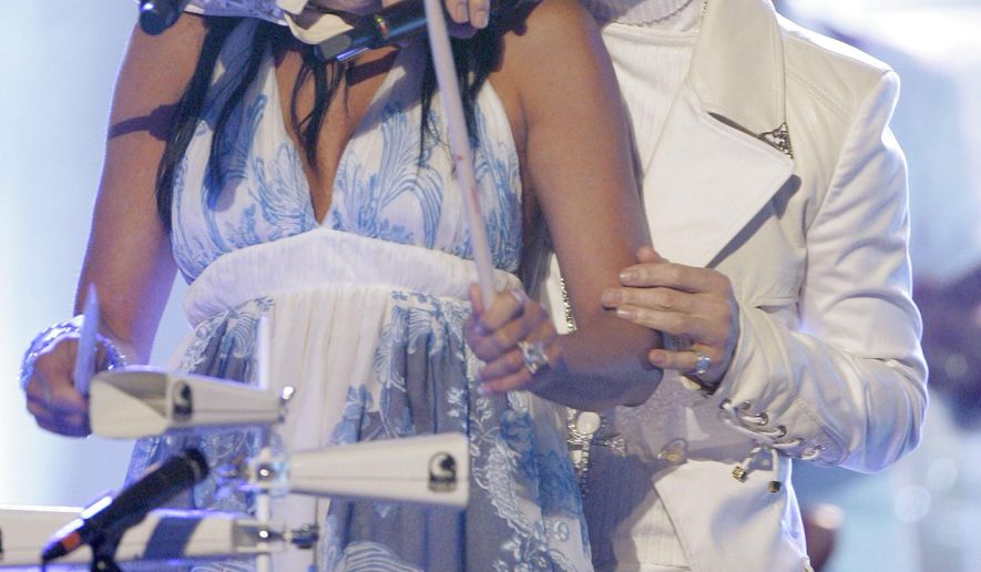 FILE - In this June 1, 2007 file photo, Prince performs with Sheila E during the 2007 National Council of La Raza ALMA Awards in Pasadena, Calif.  Sheila E. was a former percussionist and vocalist for musician Prince, who died Thursday, April 21, 2016 at his home outside Minneapolis. (AP Photo/Mark J. Terrill, File)