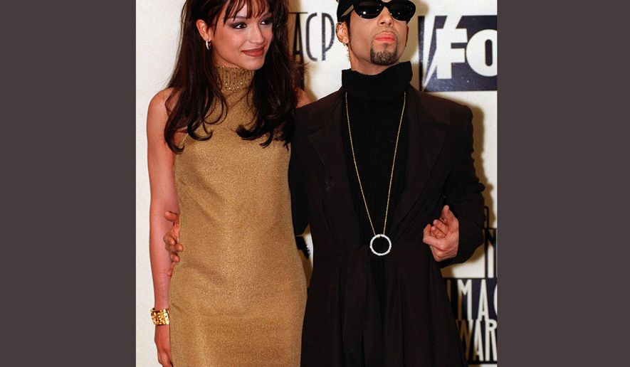 FILE - In this Feb. 8, 1997 file photo, Prince poses backstage with his wife Mayte at the 28th annual NAACP Image Awards in Pasadena, Calif. Prince died at his suburban Minneapolis home on Thursday, April 21, 2016 at the age of 57. (AP Photo/Mark J. Terrill, File)