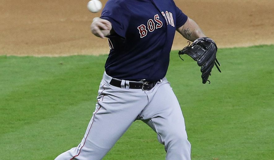 Boston Red Sox starting pitcher Steven Wright throws to first base for the out on a ground ball from Houston Astros' Tyler White during the fourth inning of a baseball game Friday, April 22, 2016, in Houston. (AP Photo/Pat Sullivan)